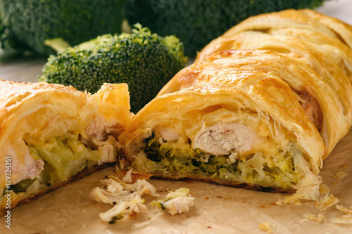 Fototapeta Homemade pie stuffed with broccoli, chicken and cheese.