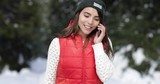 Asian Woman Using Smart Phone Messaging Call Snow Forest Girl Walking Outdoor Winter Pine Woods Slow Motion 60