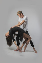 couple dancing on a white background. A guy and a girl in dance movement