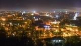Vilnius, Lithuania cityscape night time lapse paning left to right