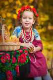 Adorable toddler girl  wearing a colorful national dress