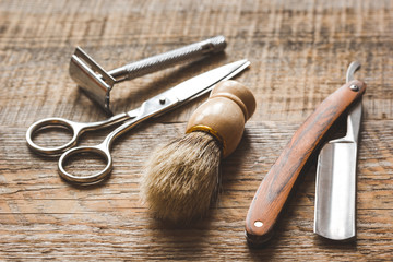 Tools for cutting beard barbershop on wooden background