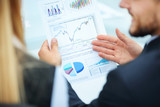 business team discussing a financial chart. accounting - 129381251