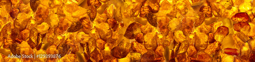 panoramic closeup baltic amber stones rectangular lie on a flat surface © torook