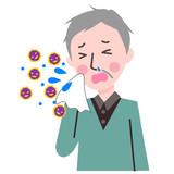 くしゃみをする高齢男性