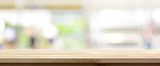 Fototapety Wood table top on blur kitchen window background, panoramic banner