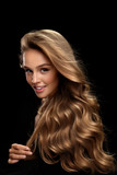 Curly Blonde Hair. Beauty Model With Gorgeous Volume Hair