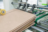 factory workshop for the production of cardboard for packaging - 129427009