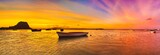 Fishing boat at sunset time. Le Morn Brabant on background. Pano