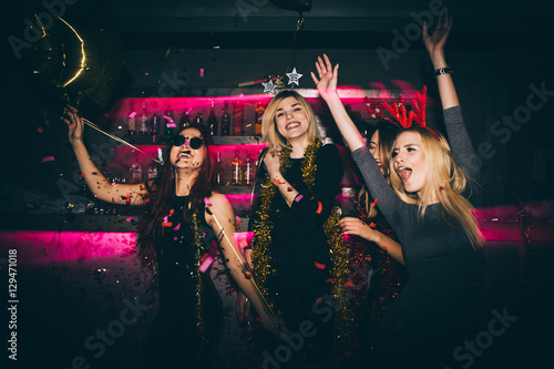 Young woman at club having fun. New year party