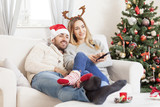 Couple in love watching TV at Christmas Eve