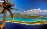 Bora Bora island and airplane propeller as seen when landing on small plane - 129478660