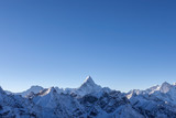 Beautiful Ama Dablam peak lit by the first rays of morning sun.