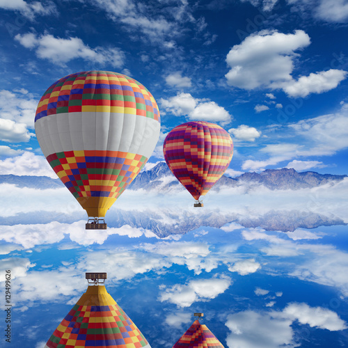 Deurstickers Ballon Colorful hot air balloons flies above calm lake