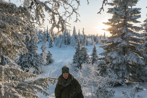 Tuinposter Fantasie Landschap cute woman in snowy frozen landscape