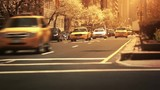 Cars passing by at dusk in Manhattan- New York. USA. Sunshine. - 129511018
