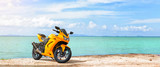Fototapety Panoramic scene of sport motorcycle at the beach