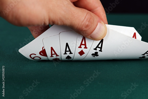 Poster Four aces on the gambling table. Winning concept. Close up