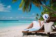 woman drinking wine on tropical beach
