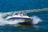 Fototapety  Girls ride on the boat to drift