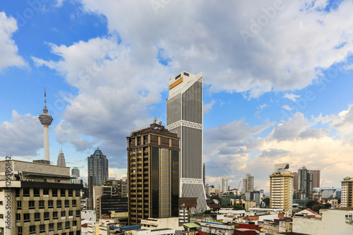 Poster Sunset over Kuala Lumpur skyline in Malaysia capital city.