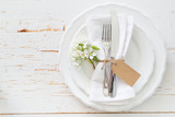 Spring table setting with white flowers - 129596886