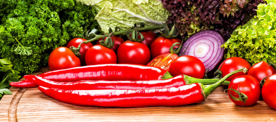 Different raw vegetables background.Cheese.