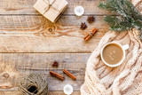 Christmas evening with cup of cocoa wooden background top view