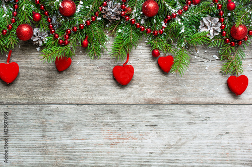 Christmas background with decorations, velvet hearts and fir tre