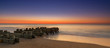 Seagirt pilings sunrise in New Jersey