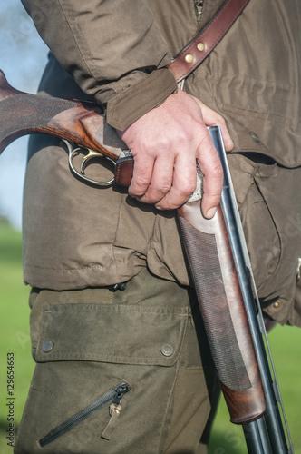 Fotobehang Jacht Hunting rifle in hunters hand