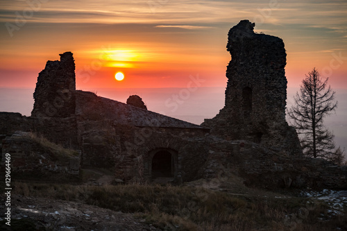 Poster The Ruins of Lichnice Castle in Czech Republic with sunset in background