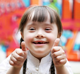 Fototapety Portrait of beautiful happy girl giving thumbs up.