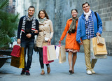 Group of adults with shopping bags