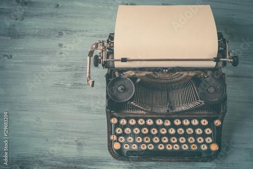 Old black typewriter with paper