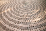 Concrete paving blocks, sorted into circle. - 129687656