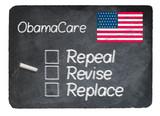 Obamacare concept using chalk on slate blackboard