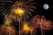 set of fireworks on black background with super moon