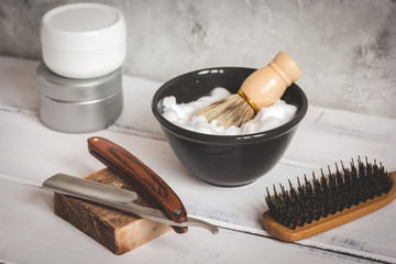Wooden desktop with tools for shaving beards