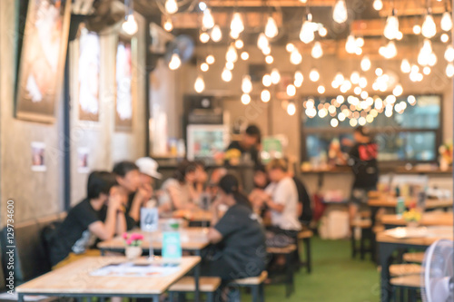 Fototapeta Blur coffee shop or cafe restaurant with abstract bokeh light im