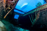 Dive boat viewed from an underwater shipwreck