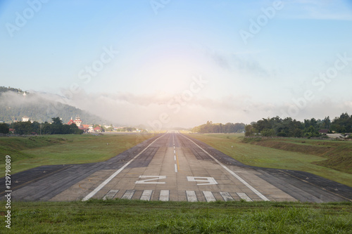 Airport runway with mountain in countryside