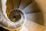 narrow stone spiral stairway
