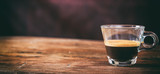 Transparent cup of espresso