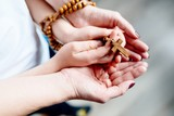 Family prayer with wooden rosary