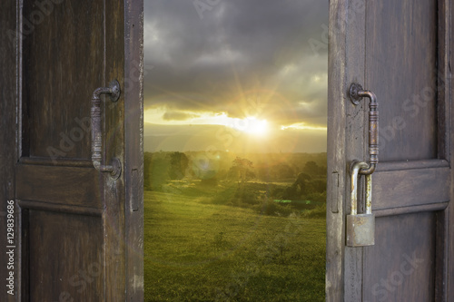 abstract old wood window open to landscape sun light filter - can use to display or montage on product - 129839686