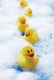 Row of rubber ducks in bubble bath elevated view close-up - 129866297