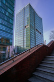 Stone staircase and modern office buildings in the city center to Poznan. - 129922888