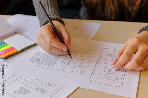 Designer wireframing a mobile App Poster