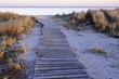Wavy boardwalk across small dune
